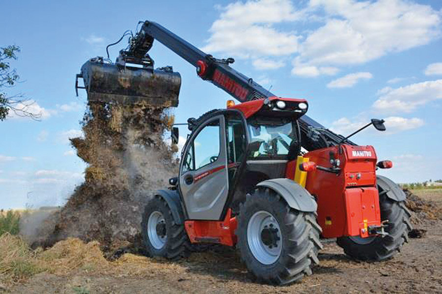 tractor lifting dirt