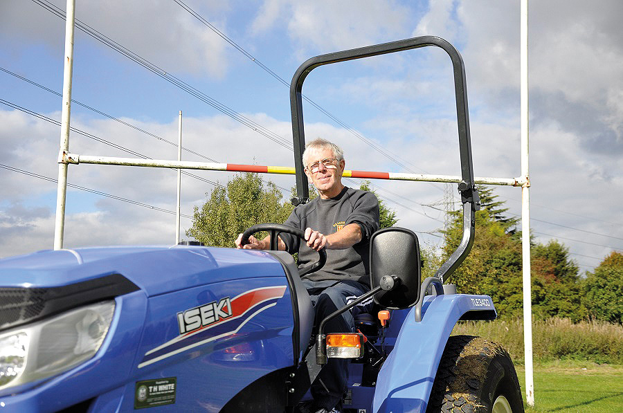 man on blue tractor