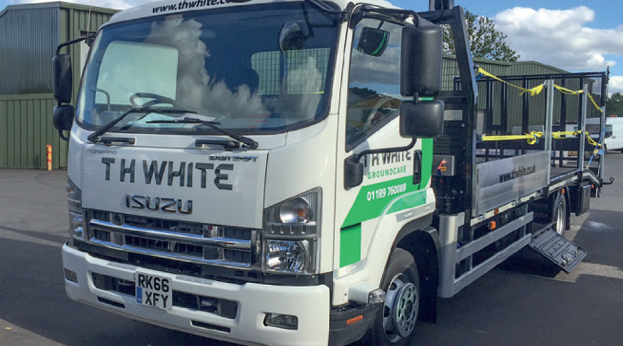 th white isuzu lorries