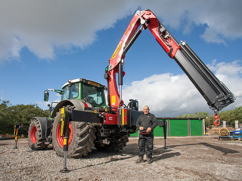 TRACTOR AND CRANE COMBINATION IS THE PERFECT MATCH FOR UTILITY WORK