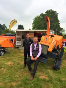 Nathan Jacobs and Bill Johnston on the Jensen woodchippers stand at Arb Show 2019