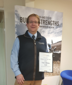 Adrian Lovegrove, Operations Director celebrating Hay & Forage award